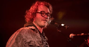 Singer Amos Lee performs onstage during AMERICANAFEST's Pre-GRAMMY Salute to Willie Nelson at The Troubadour.