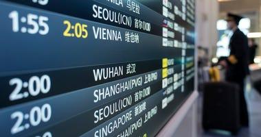 A board displays airline departure information