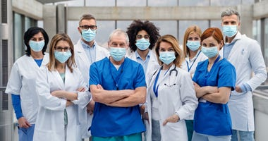 Group of health care workers in face masks