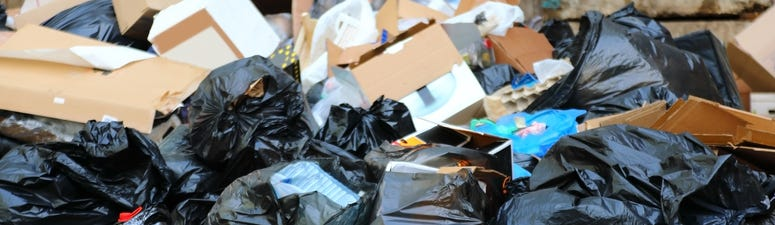 Boxes and bags of garbage piled up.