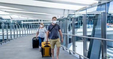 Air passengers wearing masks
