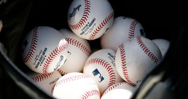 VARIOUS CITIES, - MARCH 12: A detail of baseballs during a Grapefruit League spring training game between the Washington Nationals and the New York Yankees .