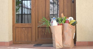 Groceries delivered in front of a house
