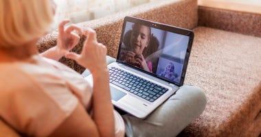 Girl talking to grandmother via video chat during quarantine