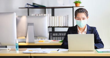 Employee wears face mask at work.