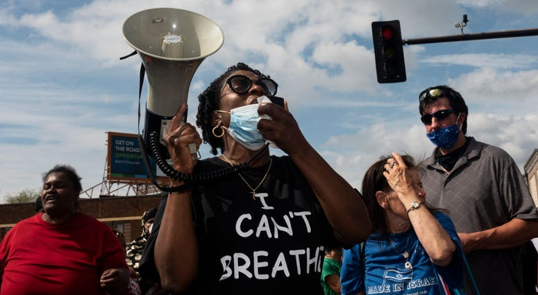 Protesters call for justice for George Floyd following his death on Monday outside the Cup Foods on May 26, 2020 in Minneapolis, Minnesota.