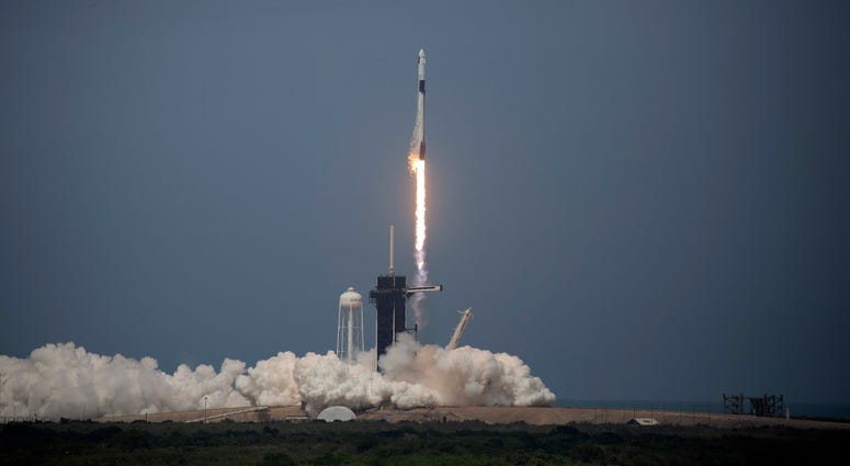 The SpaceX Falcon 9 rocket launches into space with NASA astronauts Bob Behnken and Doug Hurley aboard the rocket from the Kennedy Space Center on May 30, 2020 in Cape Canaveral, Florida.