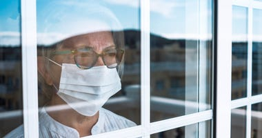 Senior citizen staying inside to avoid chances of COVID-19 contagion
