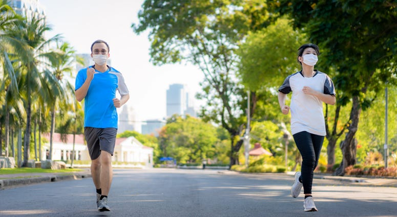 Two people jogging outside