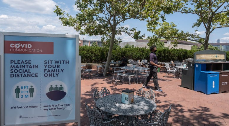 A man wearing a protective mask walks in the cafeteria as it reopened on Liberty Island on July 20, 2020