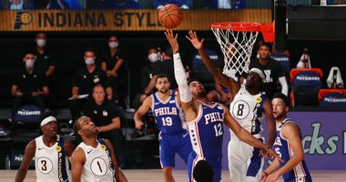 Sixers power forward Tobias Harris shoots the ball against Indiana's Justin Holiday during the third quarter of an NBA game at the Visa Athletic Center in the ESPN Wide World Of Sports Complex on August 1, 2020 in Lake Buena Vista, Florida.