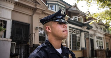 Officer Adam Fulmore, of the Camden County Police Department, goes on a foot patrol on August 22, 2013 in the Parkside neighborhood of Camden.
