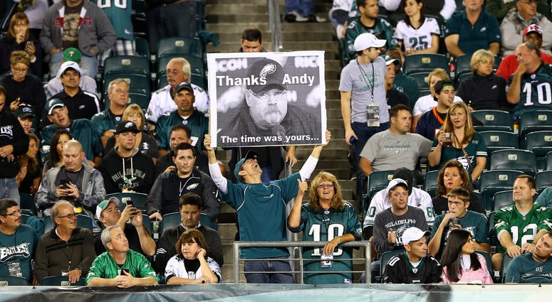 Eagles fan holds up a sign for head coach Andy Reid