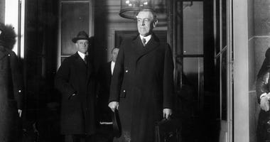 President Woodrow Wilson leaving the Quai d'Orsay at the start of the Paris Peace Conference known as the Treaty of Versailles.