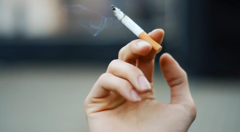 A person holding a cigarette.