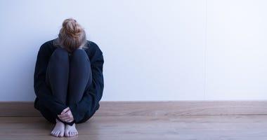 A woman sitting alone.