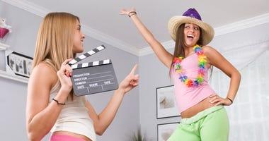 Teen girls making home movie