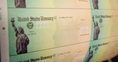 Economic stimulus checks are prepared for printing at the Philadelphia Financial Center May 8, 2008 in Philadelphia, Pennsylvania.