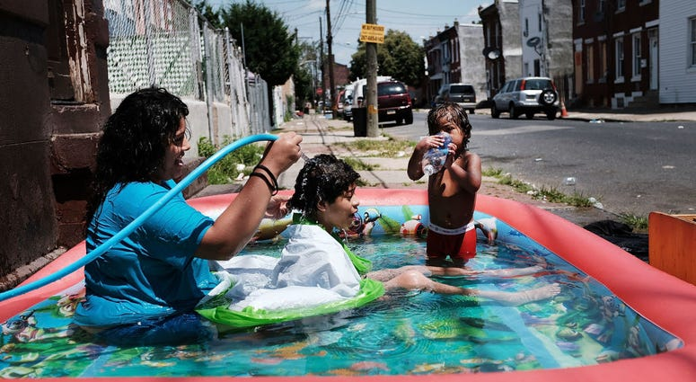 A family cools off in the Kensington section of Philadelphia.