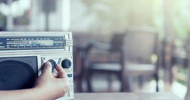 Adjusting the volume on a radio