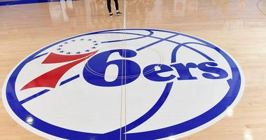 Interior of 76ers logo painted on wooden floor at Sixers Training Complex in Camden, New Jersey