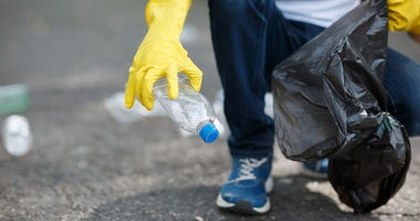 A person cleaning up litter.
