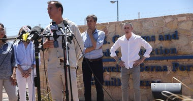 From left: Reps. Tom Suozzi (D-NY), Beto O'Rourke (D-TX) and Brian Fitzpatrick (R-PA) partricipate in a press conference after taking a tour of the recently built tent encampment near the Tornillo-Guadalupe Port of Entry on June 23 in Tornillo, Texas.