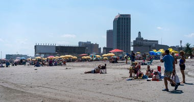 Visitors hang out on the beach on June 29, 2018 in Atlantic City, New Jersey. Two new casinos opened this week in the seaside resort, as residents seek an economic upswing.