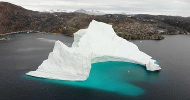 Massice Iceberg Threatening Greenland Village