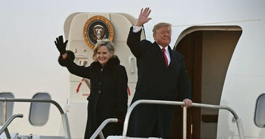 President Donald Trump and Sen. Cindy Hyde-Smith, R-Miss., wave to supporters after arriving for a rally in Tupelo, Miss., Monday, Nov. 26, 2018.