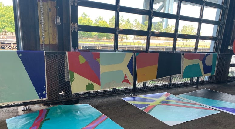 Members of the public were invited to help paint sections of a mural at Cherry Street Pier.