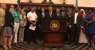 City, state and federal officials speak from Philadelphia City Hall about the shooting incident on Wednesday.