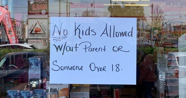 The assistant manager of a South Philadelphia dollar store has posted a note on the door saying kids need to be accompanied by a parent or someone over 18.