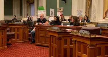 Animal welfare advocates (from left) Ian Griffiths, Anita Kay and Marsha Perelman testify for more funding for ACCT at a Philadelphia City Council hearing.