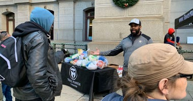 Jimmy White opens the turkey giveaway pop-up at City Hall.