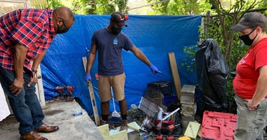 Contractor Raheem David (middle) works with a crew performing home repairs on behalf of nonprofit Rebuilding Together Philadelphia.