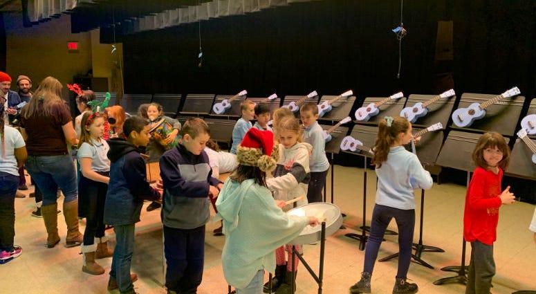 Students at Hackett Elementar get new instruments.