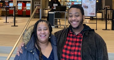Nikki Butler and her son Nickolas at the AMC theater in Philadelphia's Fashion District