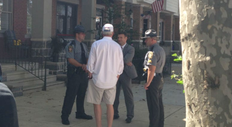 In this photo, John Dougherty is seen talking to agents when federal authorities raided his house in August 2016.