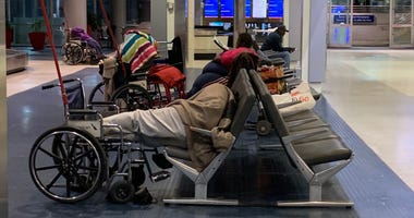 Dozens of homeless have taken up residence at Philadelphia International Airport, but a new rule limiting access to passengers and workers effective Friday has officials working to relocate them.