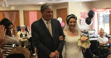 A mock wedding ceremony at the Jefferson Health Care Center included a bride, who works at the facility, and a groom, who used to work there.