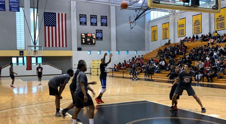 Philly cops and a group of young men play a friendly game of basketball at Community College of Philadelphia.