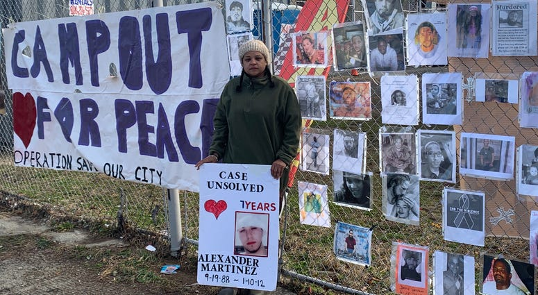 Operation Save Our City founder Rosalind Pichardo poses with a photograph or her brother, whose 2012 murder remains unsolved.