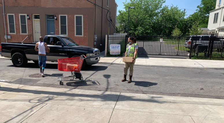 Volunteers provide food to communities whose grocery stores were looted, destroyed.