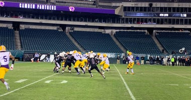 Pleasantville and Camden high schools finish their football game at Lincoln Financial Field.