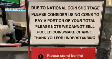 Sign announcing national coin shortage at a store