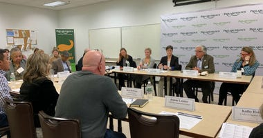 Pa. DHS secretary Teresa Miller, center, hosted a roundtable Monday at the offices of Philabundance.