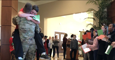 Mark Ditizio and his brother, Private Second Class Eric Shaw, share a long hug.