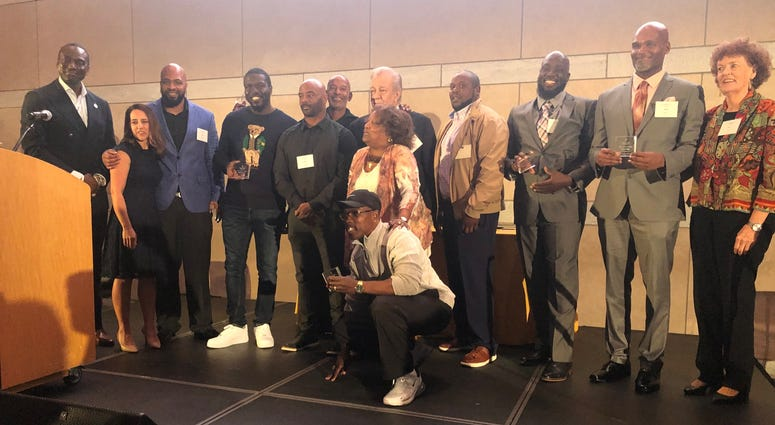 Dr. Yusef Salaam (left) with Innocence Project leaders and exonerees
