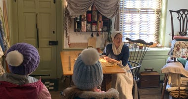 Betsy Ross (played by Jennifer Gray) addresses visitors during a meet and greet at the Betsy Ross House in Old City.